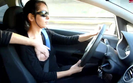 Brown-haired amateur girl drives a car and jerks a dick