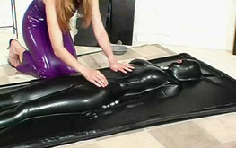 Mademoiselle in purple dress and her personal latex doll