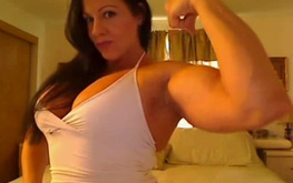 Muscular webcam babe teases